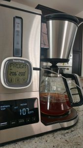 A digital thermometer is attached to the coffeemaker. It shows a temperature of 200 degrees.