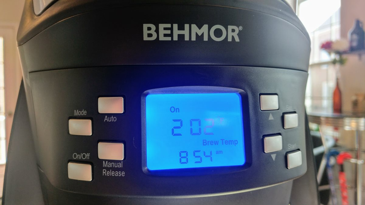 A closeup of the blue display panel. The display indicates that the water is at 202 degrees and that the brew cycle is in progress.