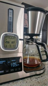 A digital thermometer is attached to the coffeemaker. It shows a temperature of 189 degrees.