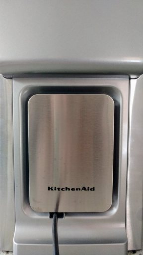 "A view of the back of the KitchenAid KCM0802. A cord wrap is built into the unit, and takes up approximately 16"" of power cord."