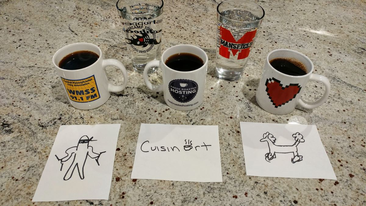 "Three coffee mugs, each filled with coffee, and two pint-size glasses of water are pictured on a granite countertop. Hand-drawn signs illustrate which coffee cup came from which brewing method. Drawings of a ninja and a French poodle are used to indicate coffee from the Ninja and French press, respectively. The label for ""Cuisinart"" has a coffee mug in place of the ""a""."